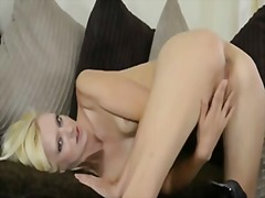Perky blonde has a hot orgasm after fingering herself.