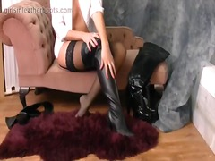 Hot busty babe puts on her thigh high leather boots.
