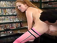Redhead in sexy thigh high nylons getting fucked.