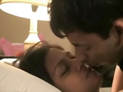 indian couple honeymoon passionate giving a kiss and sex.