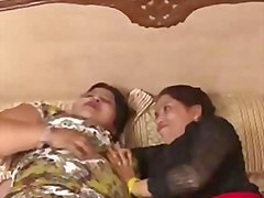 two mature indian aunty enjoying boobs press.